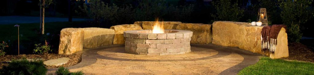 Natural stone firepit with semi-circular wall