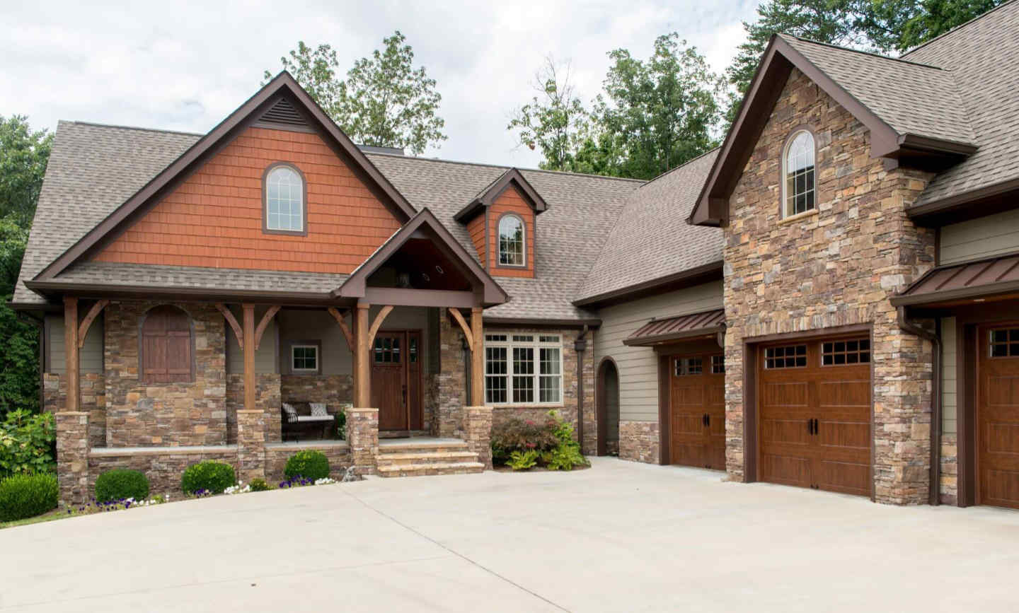 Lovely stone veneer exterior panels are used for siding on this exquisite home.
