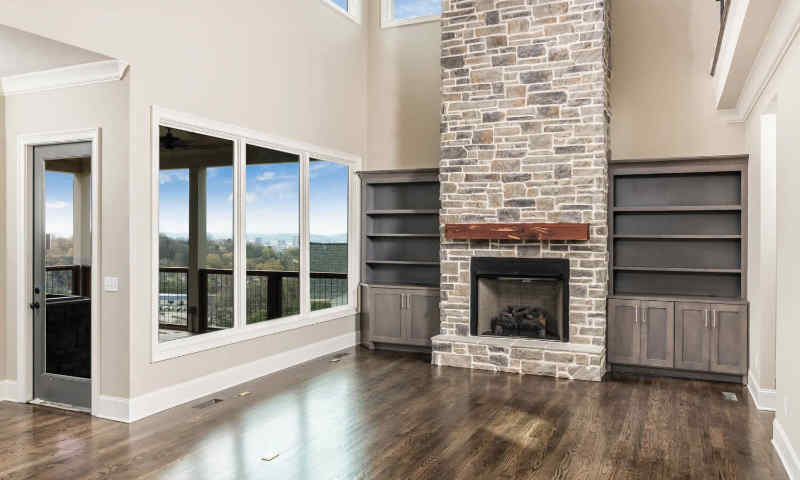 Stone veneer on this fireplace beautifies it and the entire room.