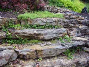 Ledge stone natural rock wall is ideal to tame hills and grade changes