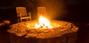 Use a fire pit kit to create a winter gathering place.