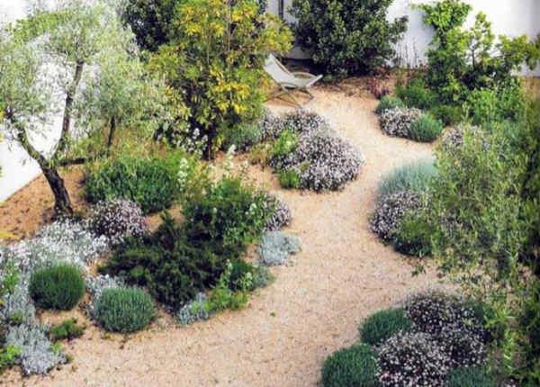 Use of decorative gravel displayed in a Mediterranean style garden
