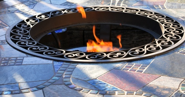 In-ground firepit with decorative stone and ring