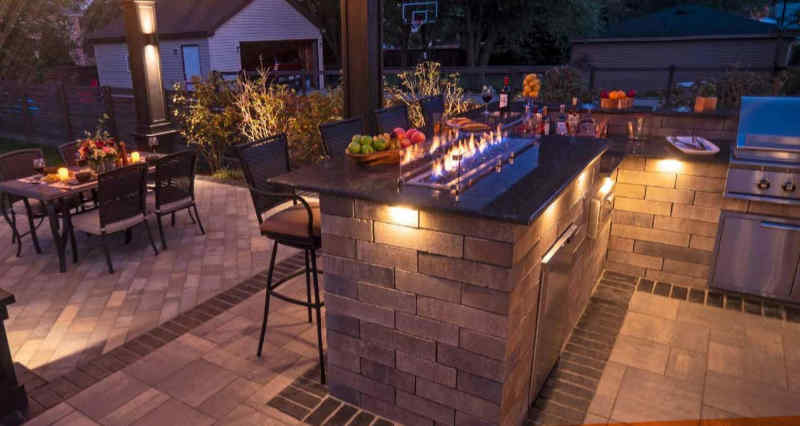 Fire table included in an outdoor kitchen design