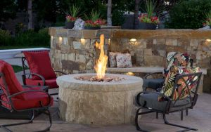 Fire pit set against natural stone wall backdrop