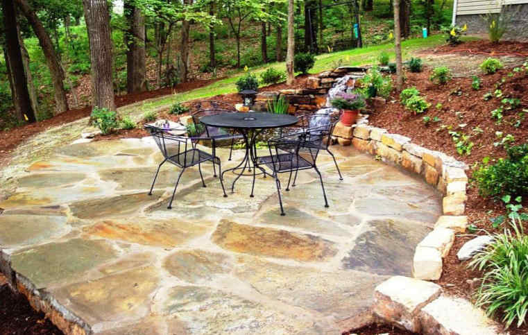 Traditional patio furniture on a flagstone patio.