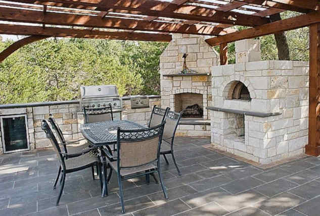 Outdoor pizza oven on a stone patio
