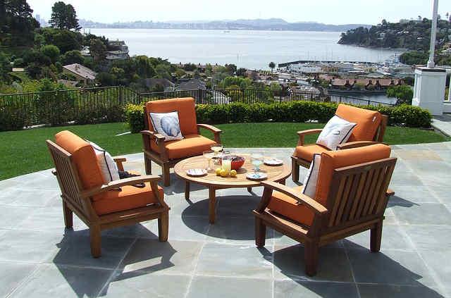 Orange patio furniture on a natural stone tile patio
