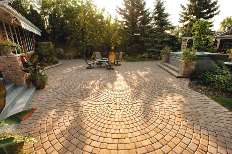 Patio designed with pavers in an attractive circular pattern.