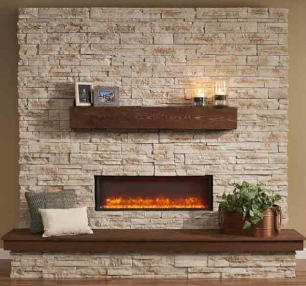 Stone veneer fireplace surround installed with an electric fireplace