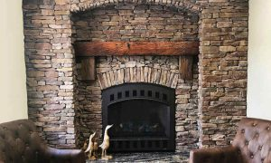 Natural stone facade and wood hearth for a fireplace