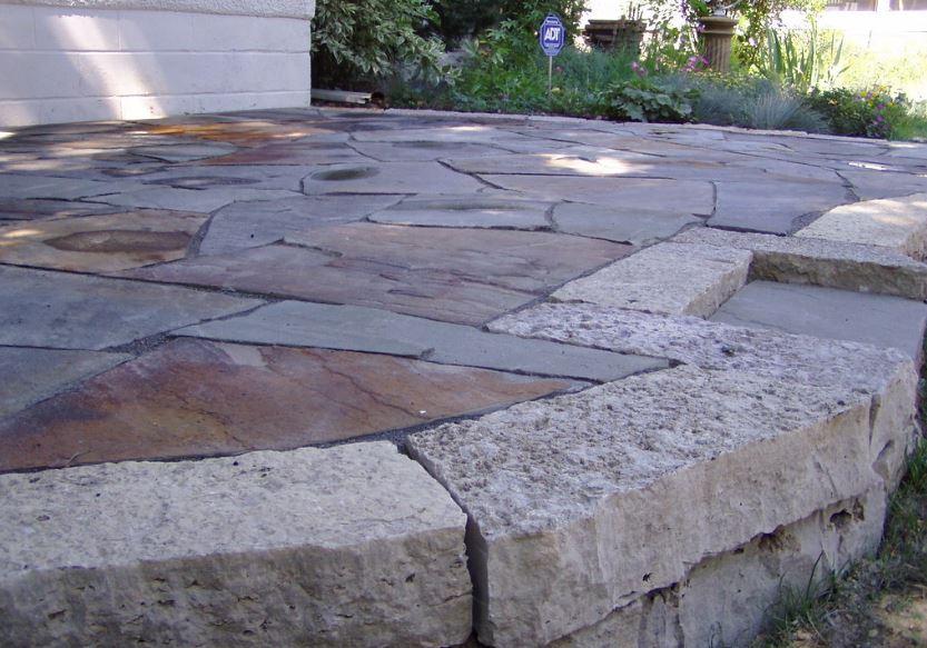 A raised flagstone patio