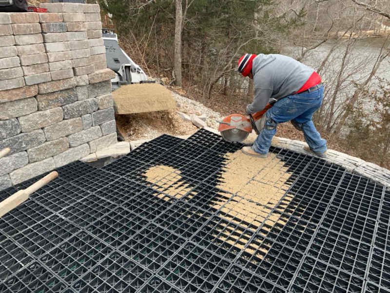 Landscape construction contractors cutting the Silca SoilGrid with a power saw.