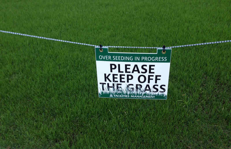 Nice Osage Beach Missouri lawn with a Keep off the grass sign