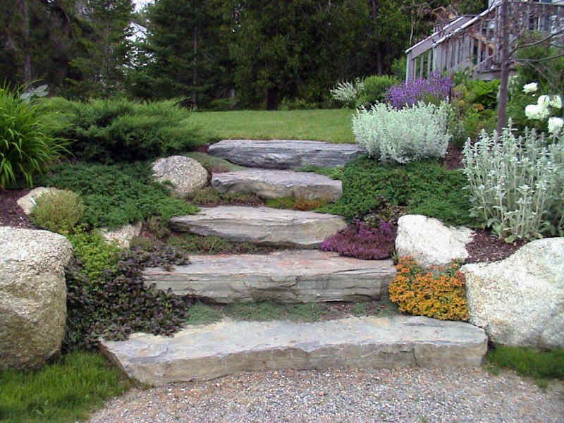 Natural stone steps and boulders in a designer landscape in Columbia, Missouri