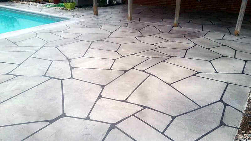 Flagstone pavers act as a slip-resistant pool deck on this patio