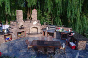 Ariel view of natural stone outdoor kitchen on a beautiful blue flagstone patio