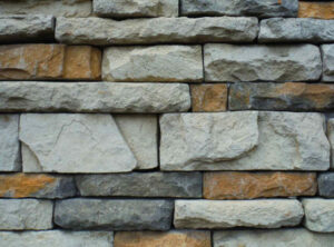 Close-up of a thin stone veneer siding on a house