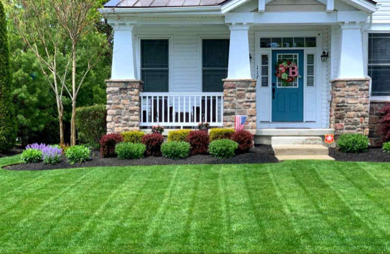 Beautiful lawn in front of a nicely landscaped home