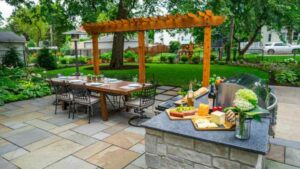 Patio and pergola with Penssylvania bluestone pavers used as flooring