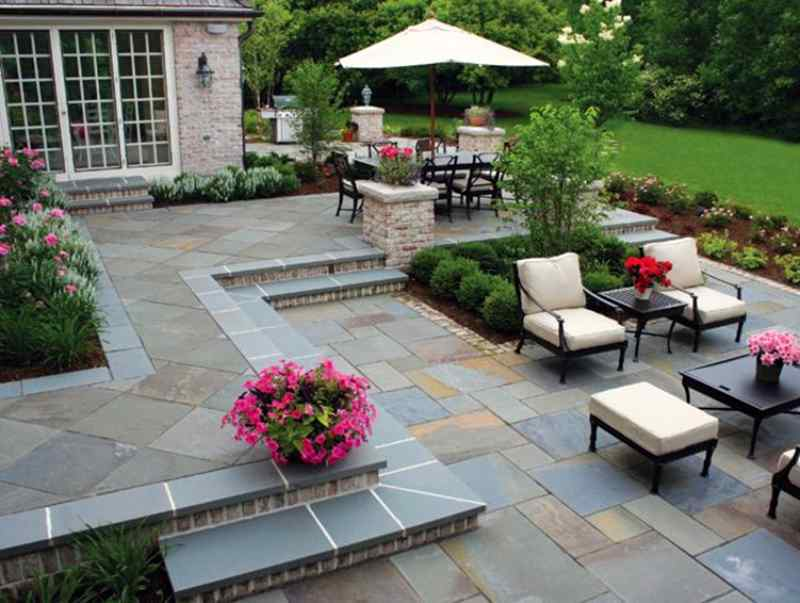 Beautiful Pennsylvania bluestone patio with chairs and a patio table