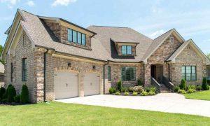 Luxury home with real stone veneer siding
