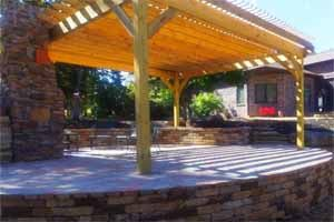 Patio using natural stone with a pergola covering it